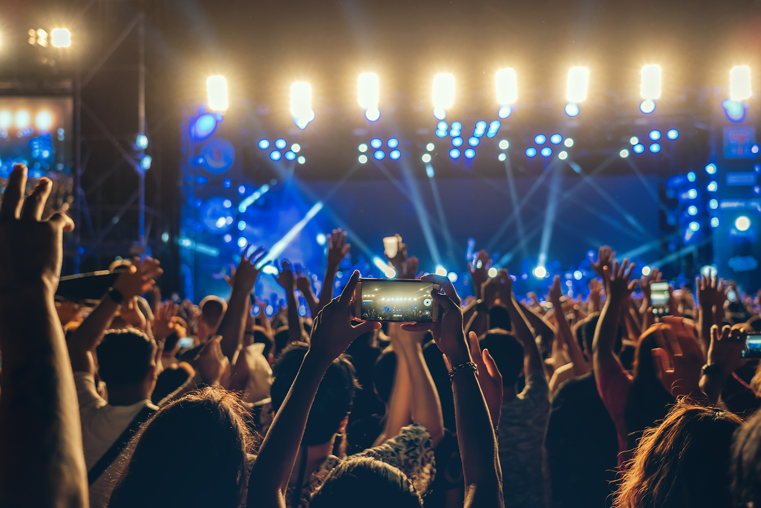 Concert crowd of Music fanclub hand using cellphone taking video